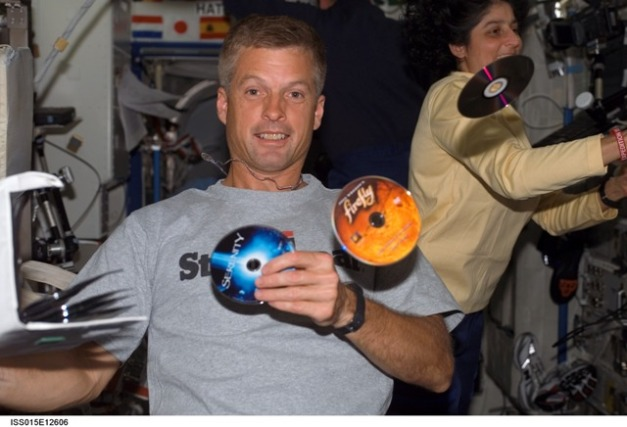 Firefly and Serenity discs float in microgravity aboard the International Space Station
